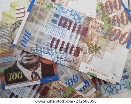 banknotes in denominations of 100 NIS - stock photo