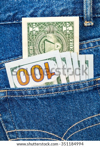 Banknotes of american dollars in the back jeans pocket - stock photo
