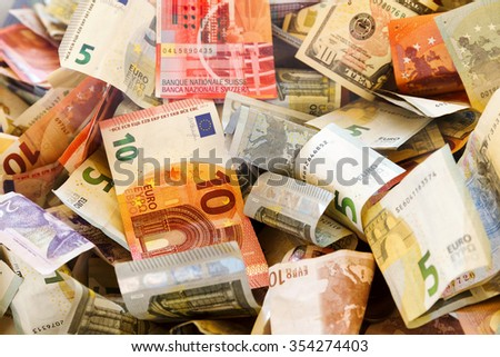 Banknotes of different countries and wrinkled overlapping randomly. Banknotes, euro, dollar, pound, ruble, various sizes, multi-color, banknotes.