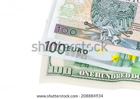 Banknotes of 100 dollars euro and polish zloty isolated on white background with clipping path - stock photo