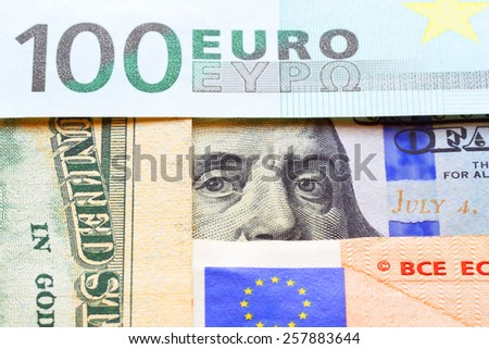 Banknotes of euro and dollars. - stock photo