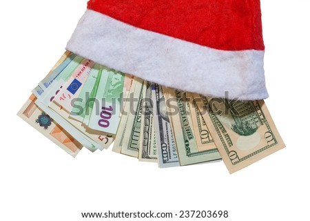banknotes of euro and dollars in santa hat on a white background - stock photo