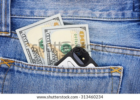 Banknotes of one hundred american dollars and mobile phone in the jeans pocket - stock photo