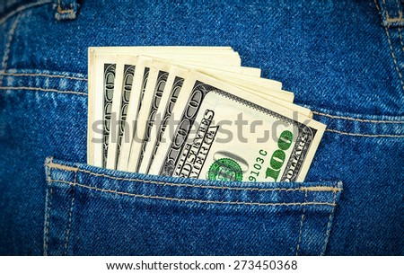 Banknotes of one hundred american dollars in the back jeans pocket - stock photo