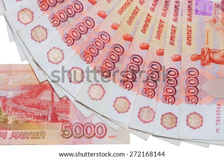 Banknotes of 5000 Russian rubles are located around as a fan and part of 5000 rubles banknotes on a white background