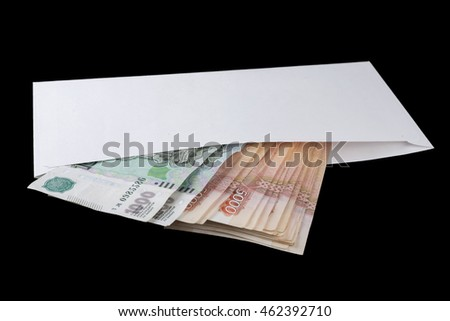 Banknotes of Russian rubles in white envelope on black background