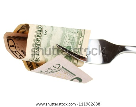 Banknotes on a fork on white background close-up