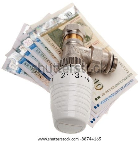 Banknotes with heating Thermostat isolated on white background - stock photo