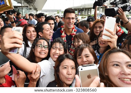 BANKOK THAILAND OCTOBER 01:Serbia's Novak Djokovic shot selfie with the fans during ahead of their exhibition tennis match at suvarnabhumi airport  on Oct 1, 2015 in Thailand.  - stock photo
