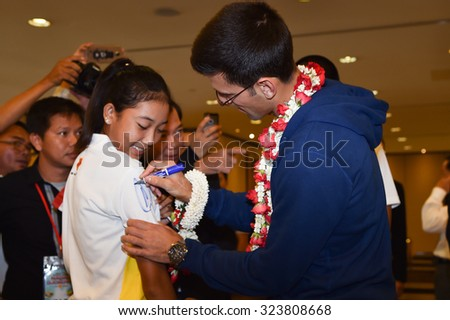 BANKOK THAILAND OCTOBER 01:Serbia's Novak Djokovic signs autographs for fans as he arrives in the lead up to The exhibition tennis match at suvarnabhumi airport  on Oct 1, 2015 in Thailand.