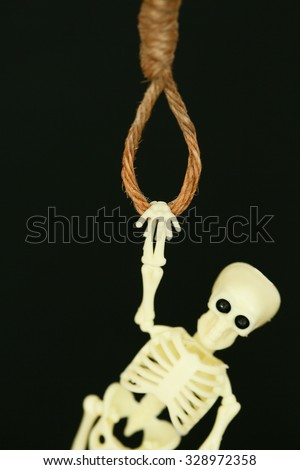 bankrupt concept, rope noose with hangman's knot hanging in front, Halloween background. - stock photo
