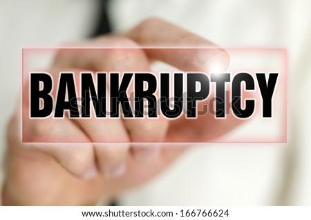 Bankruptcy button on virtual screen. - stock photo