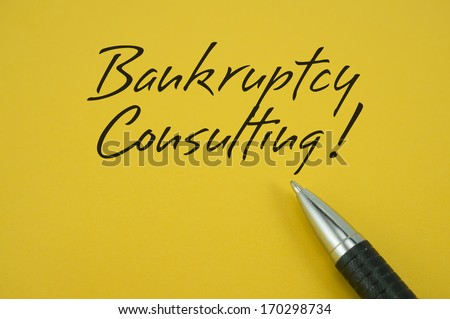 Bankruptcy Consulting! note with pen on yellow background