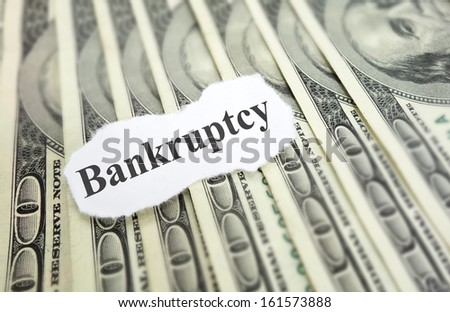 Bankruptcy news headline on cash                                - stock photo