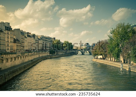 Banks of the River Seine in Paris France with vintage tone - stock photo