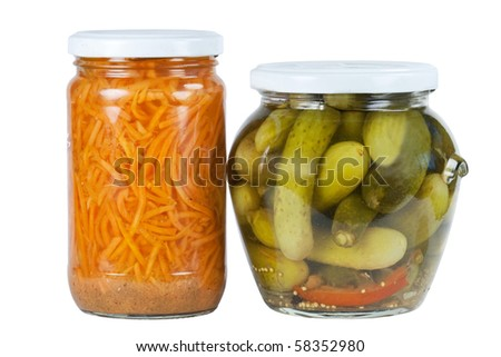 Banks pickled cucumbers and carrots on a white background