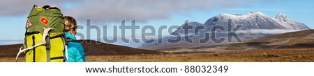 banner of Lapland with female Hiker and the Akka Massiv in Sweden - stock photo