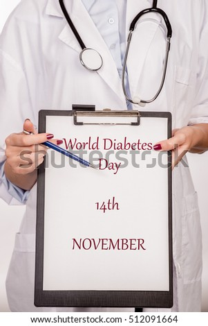 Banner with commemorative design to remind you the World Diabetes Day in November 14. Doctor holding plate with sign of World diabetes day. World diabetes day.