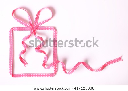 Banner with gift box made from pink ribbon, modern simple background for presentation. Original greeting, invitation card Valentines Day, Christmas, wedding, birthday, mother's day