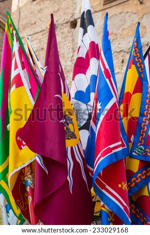 Banners of the Contrade in Siena, Tuscany, Italy - stock photo