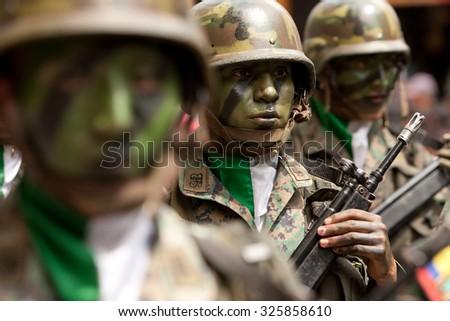 Banos De Agua Santa, Ecuador - 20 December 2011: Troops Wearing War Equipment Marching On The Streets In Banos De Agua Santa On December 20, 2011 - stock photo