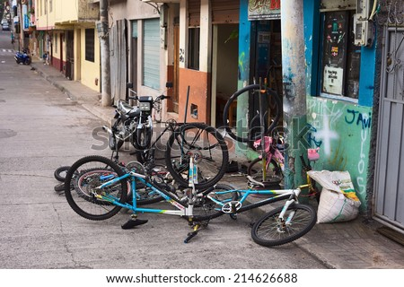 BANOS, ECUADOR - AUGUST 1, 2014: Bicycles in front of a bike repair shop on Juan Leon Mera street on August 1, 2014 in Banos, Ecuador. Banos is a small town in Tungurahua Province in Central Ecuador.  - stock photo