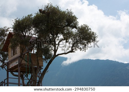 BANOS, ECUADOR - FEB 20: It i??s called the Swing at the End of the World, extreme attraction in the mountains of Ecuador lets thrill-seekers swing over an abyss. Ecuador 2015. - stock photo
