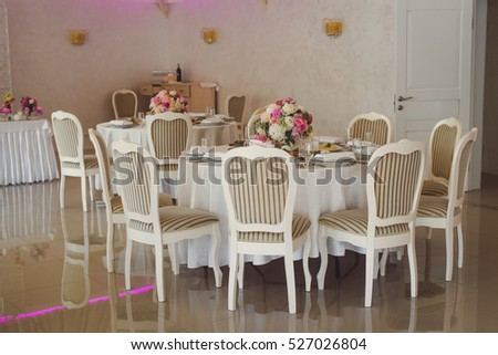Banquet hall beautifully decorated with flowers.