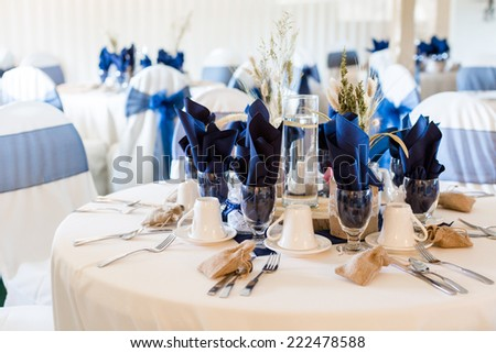 Banquet hall decorated for wedding in white and blue. - stock photo