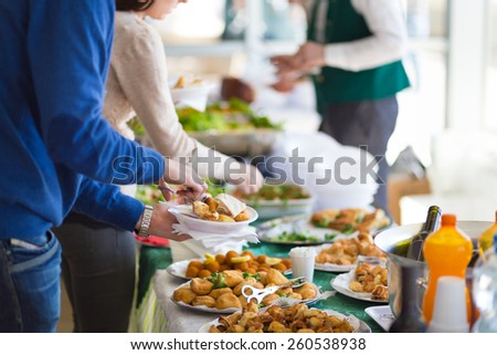 Banquet lunch break at conference meeting. Assortment of food and beverage. - stock photo
