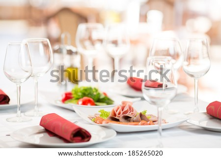 Banquet setting table in restaurant interior - stock photo