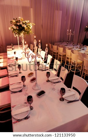 banquet table laid for a large number of people - stock photo