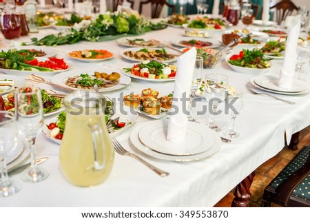 Banquet Table served in restaurant with tasty meals.