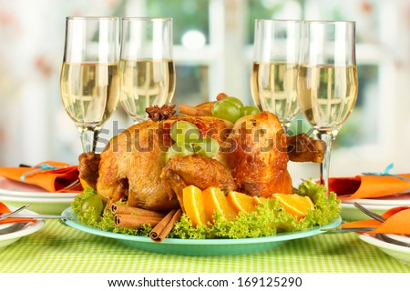 banquet table with roast chicken and glasses of wine. Thanksgiving Day