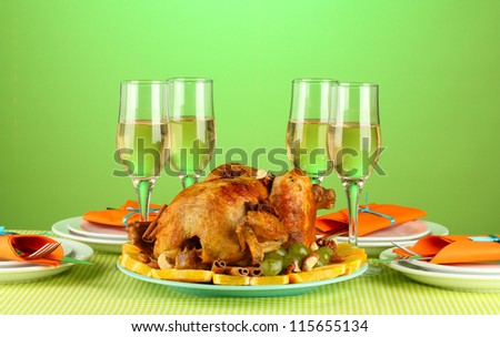 banquet table with roasted chicken on green background close-up. Thanksgiving Day