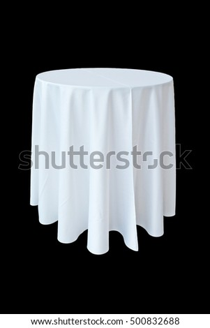 banquet table with white tablecloth isolated on black