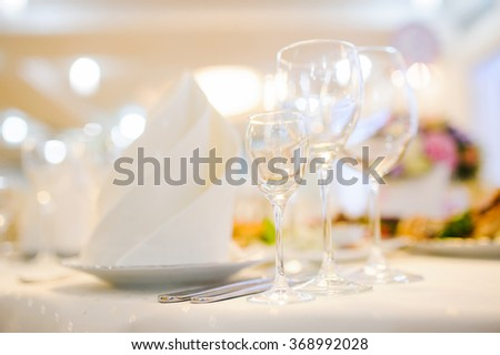 Banquet wedding table setting with plate and wineglass or glass