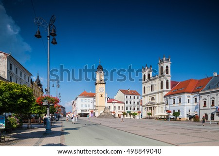 Banska Bystrica, Slovakia - august 07, 2015: Old Main Square with town halls, clock tower and St. Francis Xavier Cathedral in Banska Bystrica, Slovakia