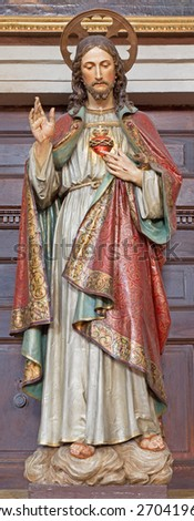 BANSKA STIAVNICA, SLOVAKIA - FEBRUARY 5, 2015: The carved and polychrome statue of heart of Jesus Christ in parish church by unknown artist of 19. cent.  - stock photo