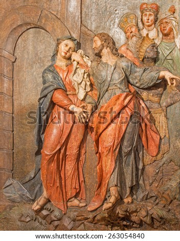 BANSKA STIAVNICA, SLOVAKIA - FEBRUARY 5, 2015: The detail of carved relief Jesus says farewell to his mother as the part of baroque Calvary from years 1744 - 1751. - stock photo