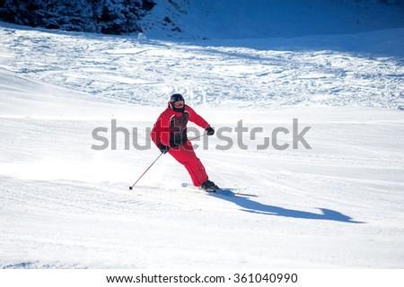 BANSKO, BULGARIA - JANUARY 1, 2016:  man skiing  at ski resort - stock photo