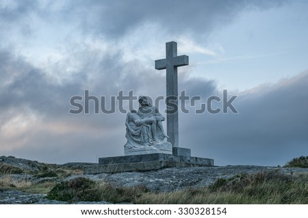 Bantry,Ireland - August 10, 2014: Marian statue and cross on Sheep's Head Peninsular.