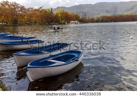 Banyoles, Spain - November 1, 2015: Lake Banyoles is the largest lake in Catalonia, Tourists enjoy the good weather and relax for boating and wooded paths. - stock photo