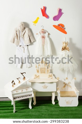 baptism clothes and accessories in a composition - stock photo