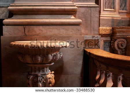 Baptismal font in stone marble; - stock photo