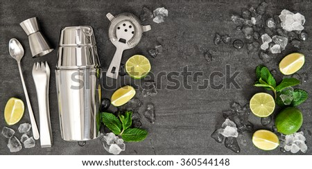 Bar accessories and ingredients for cocktail drink lime, mint, ice. Top view with space for your text - stock photo