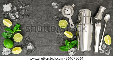 Bar accessories  ingredients for cocktail drink lime, mint leaves, ice - stock photo