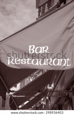 Bar and Restaurant Sign in Black and White Sepia Tone
