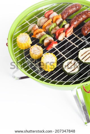 Bar-B-Q or BBQ with kebab cooking. coal grill of chicken meat skewers.barbecuing dinner  barbecue on a grilling pan  - stock photo