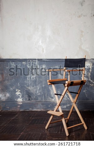 bar chair at the wall, vintage background - stock photo